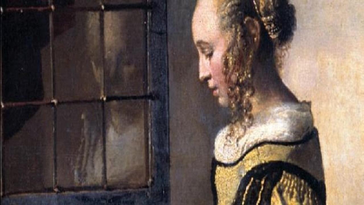 'Donna che legge' di Johannes Vermeer: ricompare un Cupido che domina dall'alto